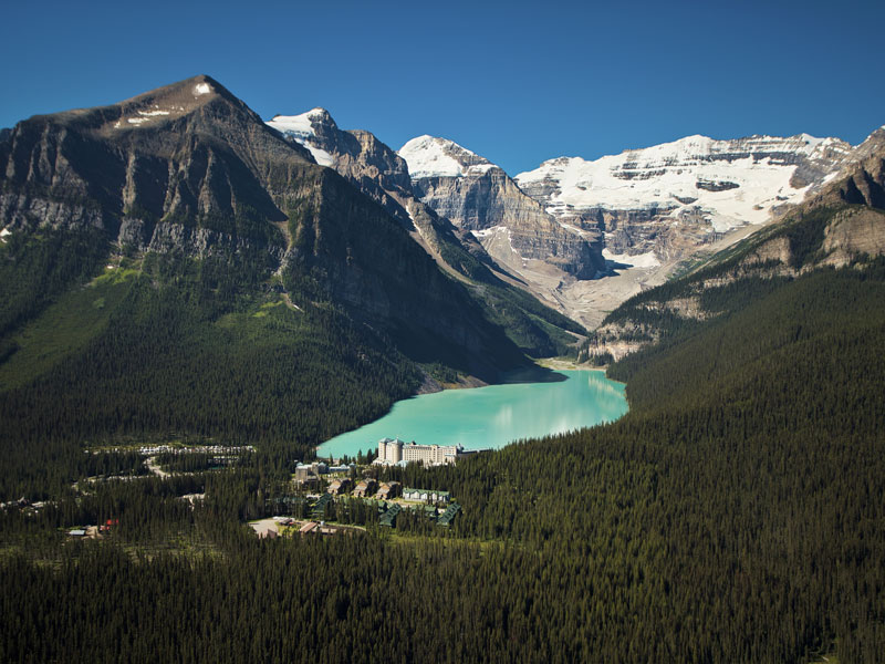 Alaska Cruise with Canadian Rockies Train Tour | Fairmont Chateau Lake Louise with the Victroria Glacier in the Canadian Rockies